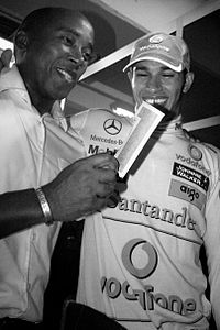 Anthony Hamilton, Lewis' father and then-manager, celebrating with his son after the 2008 Brazilian Grand Prix.