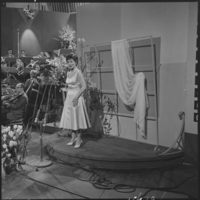 Lys Assia, the winner of the first Eurovision Song Contest for Switzerland, pictured performing at the 1958 contest