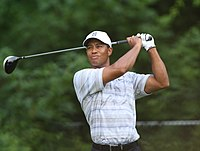 Woods checking his drive in 2007