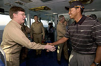 Woods visiting aircraft carrier in the Persian Gulf before participating in the 2004 Dubai Desert Classic