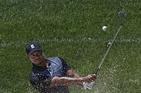 Woods practicing in a bunker prior to the start of the 2014 Quicken Loans National