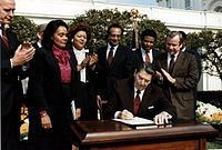 President Ronald Reagan signs the Martin Luther King bill, 1983.