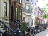 Landmark 19th-century rowhouses on tree-lined Kent Street in Greenpoint Historic District