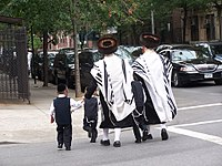 Haredi Jewish residents in Brooklyn, home to the largest Jewish community in the United States, with approximately 600,000 individuals. About 23% of the borough's population in 2011 was Jewish.