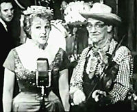 """Jo Stafford as Cinderella G. Stump with Red Ingle performing their 1947 hit, """"Tim-Tay-Shun"""", on Startime in 1960"""