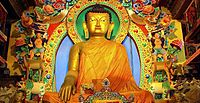 Buddhism is practised by 12% of the population. Shown here is a statue of the Buddha in Tawang, Arunachal Pradesh.
