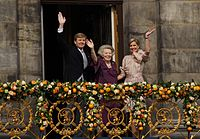 King Willem-Alexander, Princess Beatrix, and Queen Máxima greeting Amsterdammers from the Royal Palace of Amsterdam during Willem-Alexanders inauguration in 2013