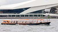 Boats give tours of the city, such as this one in front of the EYE Film Institute Netherlands.