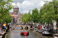 """The 17th-century Canals of Amsterdam were listed as UNESCO World Heritage sites in 2010, contributing to Amsterdam's fame as the """"Venice of the North"""". Along with De Wallen, the canals are the focal-point for tourists in the city."""