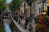 De Wallen, Amsterdam's Red-light district, offers activities such as legal prostitution and a number of coffee shops that sell cannabis. It is one of the main tourist attractions.