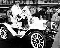 Jack Benny (shown here shaking hands with Harry S. Truman from the seat of a c. 1908 Maxwell Roadster March 21, 1958) kept the Maxwell familiar in U.S. popular culture for half a century after the brand went out of business.