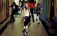 Lavigne referred the Let Go era while skateboarding wearing a tie.