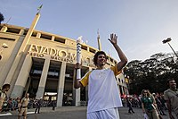 Basketball player Anderson Varejão carrying the torch in São Paulo