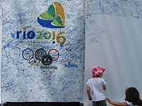 A young girl adding her signature in support of Rio de Janeiro's candidacy