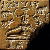 """The Pashupati seal discovered during excavation of the Indus Valley archaeological site of Mohenjo-Daro and showing a possible representation of a """"yogi"""" or """"proto-Shiva"""" figure as Paśupati (= """"Lord of the Animals""""). Circa 2350-2000 BCE."""