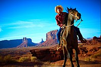 A Navajo man on horseback in Monument Valley
