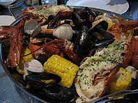 A New England clam bake consists of various steamed shellfish.