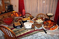 Tender, juicy roast turkey - the main attraction - with old-fashioned gravy, cranberry sauce, smashed potatoes, baked green beans, sweet and sour cod, steamed rice, achara (pickled green papaya relish), leche flan, pig in a blanket, apple crisp.