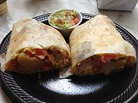 Machaca with pork, eggs, and potatoes wrapped in a tortilla, served with salsa
