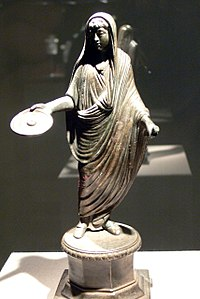 A Roman priest, his head ritually covered with a fold of his toga, extends a patera in a gesture of libation (2nd–3rd century)