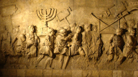 Relief from the Arch of Titus in Rome depicting a menorah and other spoils from the Temple of Jerusalem carried in Roman triumph.