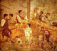 A multigenerational banquet depicted on a wall painting from Pompeii (1st century AD)
