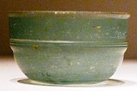 A green Roman glass cup unearthed from an Eastern Han Dynasty (25–220 AD) tomb in Guangxi, southern China; the earliest Roman glassware found in China was discovered in a Western Han tomb in Guangzhou, dated to the early 1st century BC, and ostensibly came via the maritime route through the South China Sea