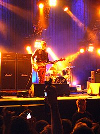Oasis performing in Hong Kong in April 2009 during the Dig Out Your Soul Tour, their last tour to date