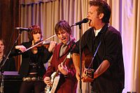 Mellencamp (right) and his band perform at Walter Reed Army Medical Center in 2007.