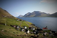 The village of Kunoy on Kunoy island, in the Faroe Islands. Kalsoy island is at right.