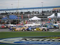 Michael Waltrip's No. 55 and Michael McDowell's No. 00 on pit road at Daytona in July 2008