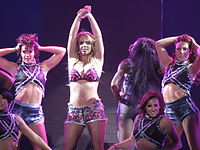 """Spears performing """"I'm a Slave 4 U"""" on the Femme Fatale Tour in 2011."""