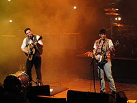 Marcus Mumford and Winston Marshall on stage in Brighton, 4 October 2010