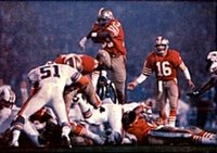 Roger Craig (middle) and Joe Montana (right) led the 49ers to their second Super Bowl victory (XIX) in four seasons.