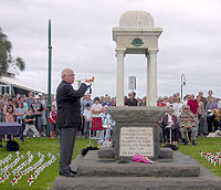 The Last Post is played at an Anzac Day ceremony in Port Melbourne, Victoria. Similar ceremonies are held in many suburbs and towns.