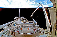 The Canadarm robotic manipulator in action on during the STS-116 mission in 2006
