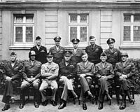From left, front row includes army officers Simpson, Patton, Spaatz, Eisenhower, Bradley, Hodges and Gerow in 1945