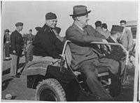 General Eisenhower, General Patton (standing to the left) and President Roosevelt in Sicily, 1943