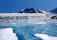 The blue ice covering Lake Fryxell, in the Transantarctic Mountains, comes from glacial meltwater from the Canada Glacier and other smaller glaciers.