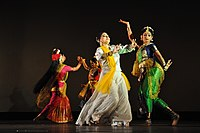 alt=Four women wearing saree in different dancing poses|Dance accompanied by Rabindra Sangeet, a music genre started by Rabindranath Tagore