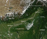 Environs: Assam, dissected hills of the South Indian Plateau system and the Himalayas all around its north, north-east and east.