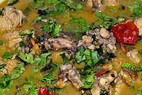 An ethnic preparation of Ghost chili chicken curry of Assam