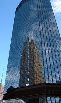 The IDS Tower, designed by Philip Johnson, is the state's tallest building, reflecting César Pelli's Art Deco-style Wells Fargo Center.