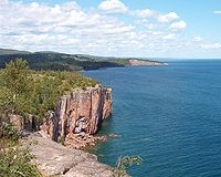 Palisade Head on Lake Superior was formed from a Precambrian rhyolitic lava flow.