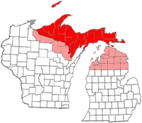 """The proposed State of Superior. The red areas show the counties of the Upper Peninsula that are generally accepted as being part of the proposed state. The pink areas show the counties of the """"expanded"""" proposal."""