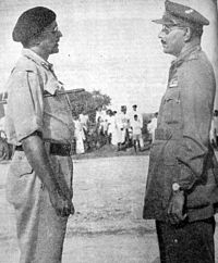Major General El Edroos (at right) offers his surrender of the Hyderabad State Forces to Major General (later Army Chief) J.N. Chaudhuri at Secunderabad