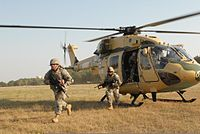 Indian Army Aviation Corps Dhruv helicopter ferrying U.S soldiers during the Yudh Abhyas training exercise in 2009