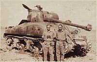 Indian Army officer next to a destroyed Pakistani Sherman tank, after the battle of Asal Uttar.
