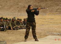 A female civilian Contractor briefing Indian Army soldiers on firing techniques.