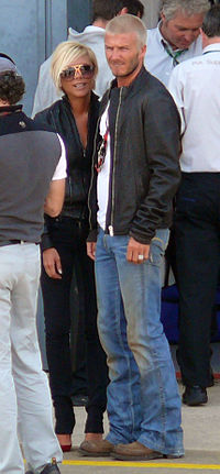 Beckham with her husband David in Silverstone Circuit during the British Grand Prix in July 2007